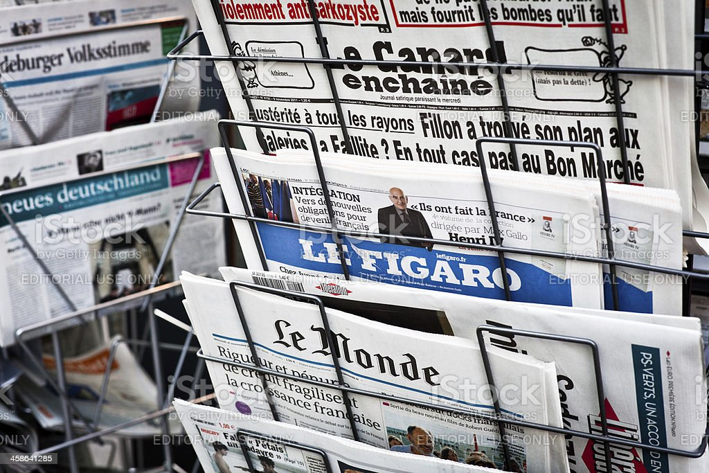 French Newspapers on a Newsstand, Figaro and Le Monde royalty-free stock photo