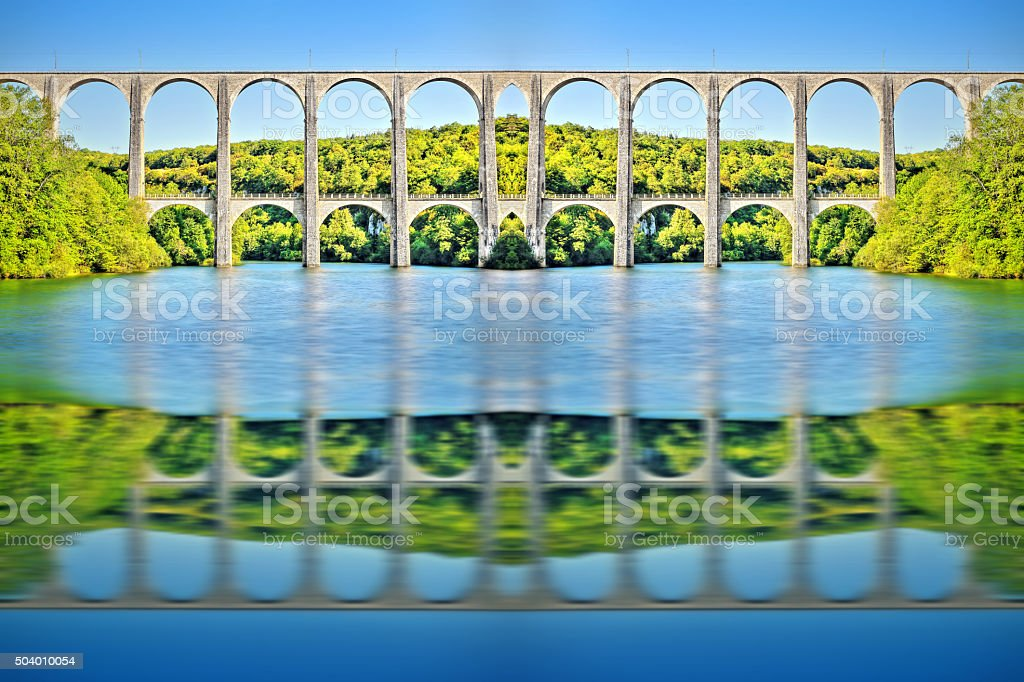 French old stone viaduct over large river symmetric shaped kaleidoscope stock photo