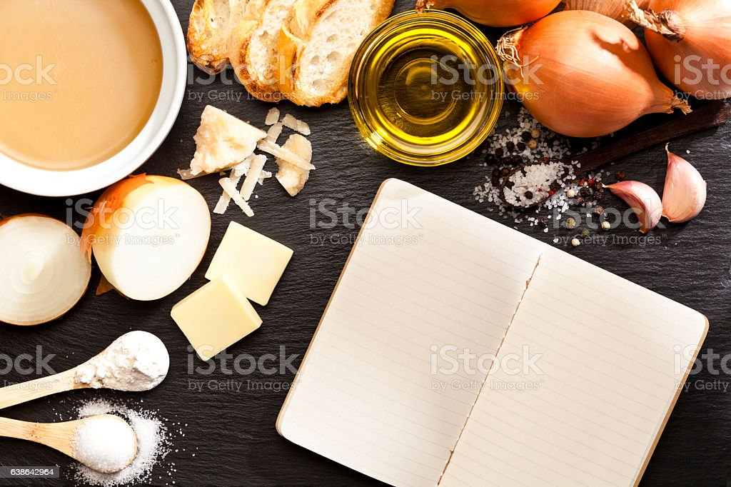 French onion soup ingredients and blank cookbook stock photo