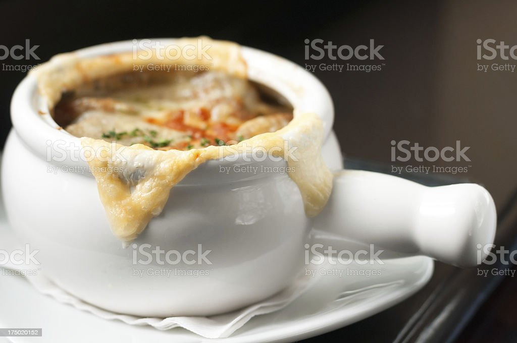 French Onion Soup on a Dark Table royalty-free stock photo