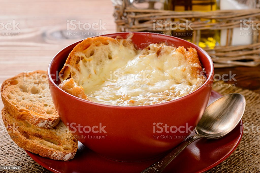 French onion soup with toasts on wooden table. stock photo