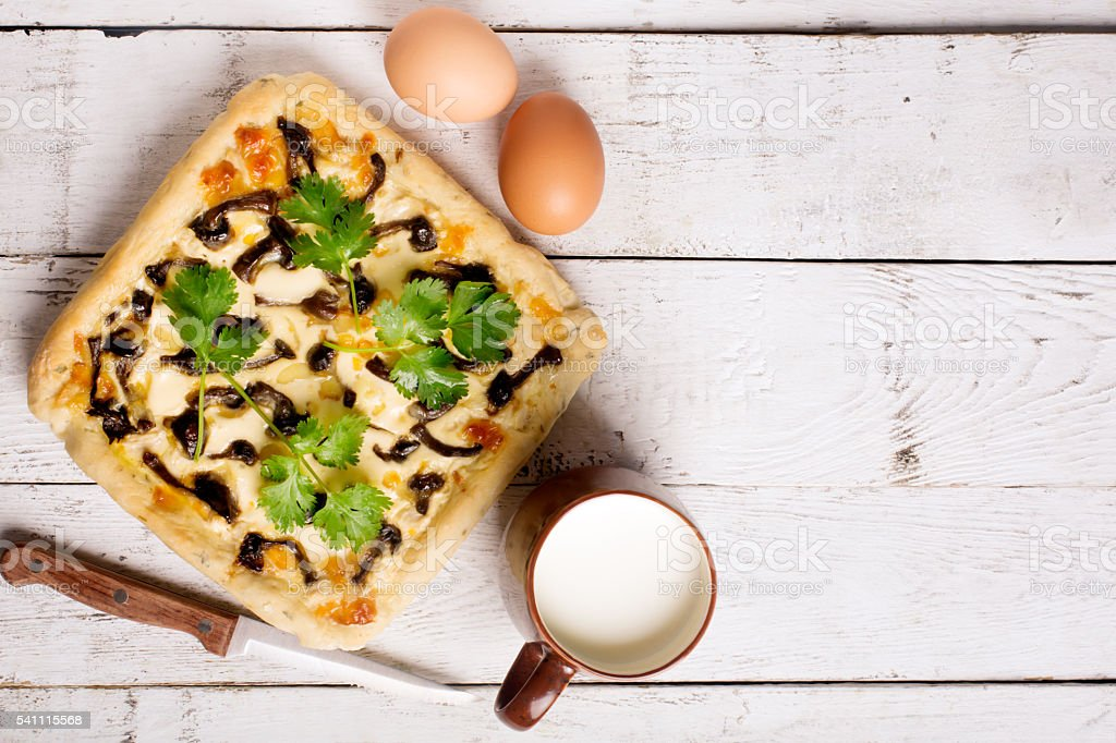 French pie on a wooden table. Top view stock photo