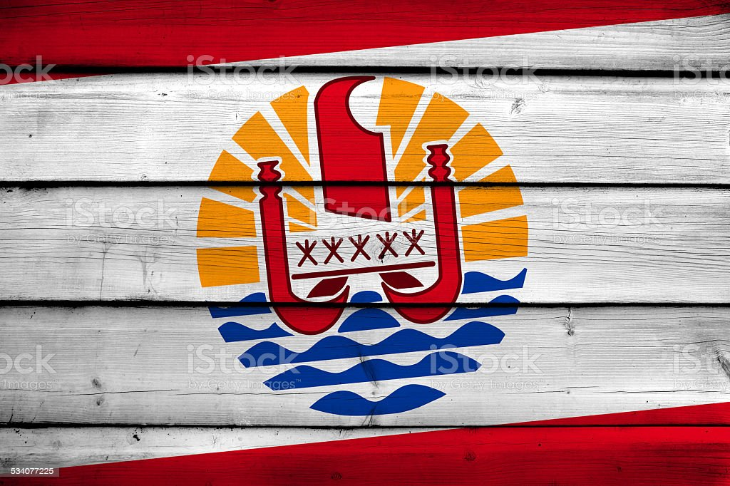 French Polynesia Flag on wood background stock photo