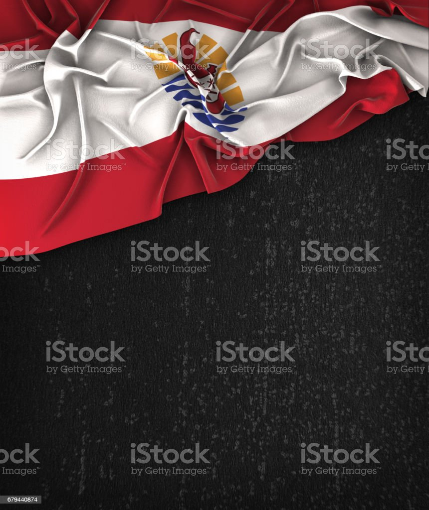French Polynesia Flag Vintage on a Grunge Black Chalkboard With Space For Text stock photo