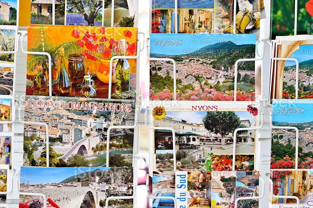 French Postcards in a rack stock photo