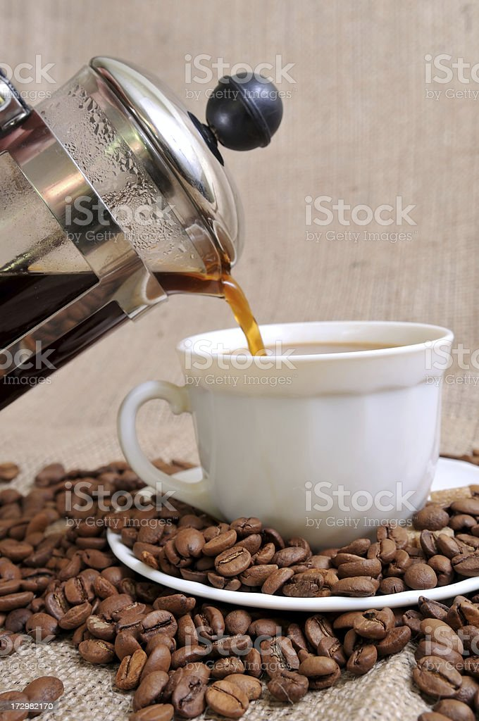 French Press and a cup of coffee royalty-free stock photo