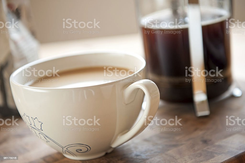French press coffee in white tea cup stock photo
