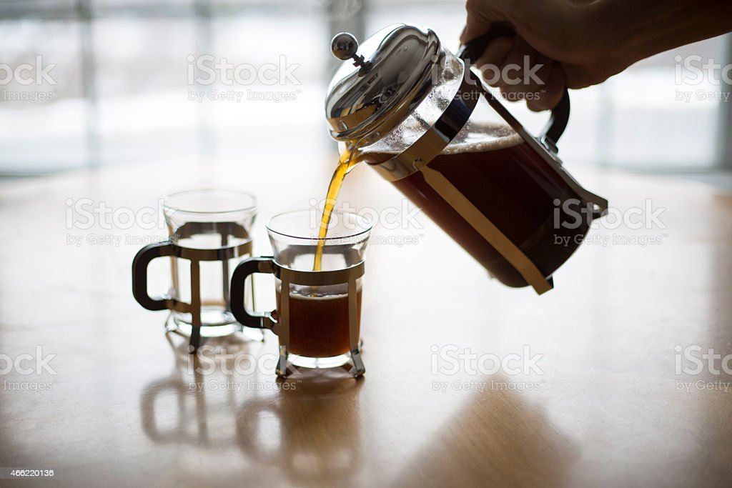 French Press Coffee Pour on a Cold Winter Morning. stock photo