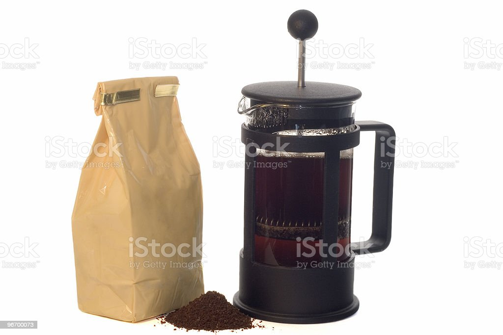 French press with a pack of coffee royalty-free stock photo