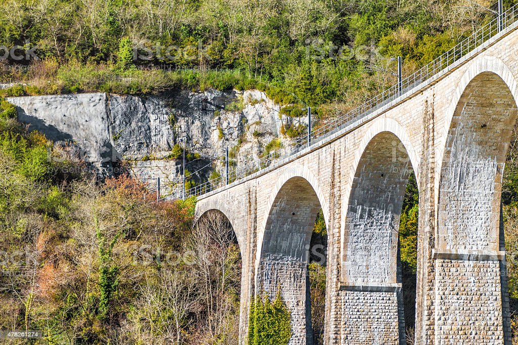 French railroad stone old viaduct in France in autumn season stock photo