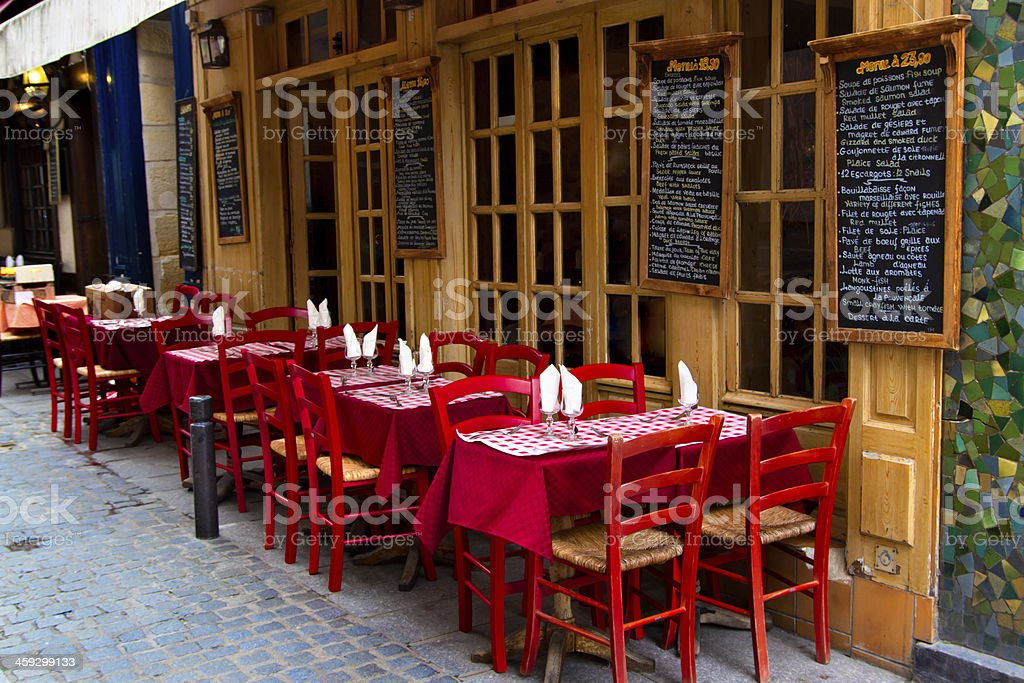 A French restaurant with tables outside stock photo