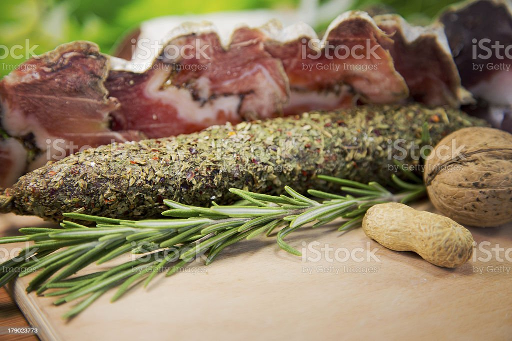 french salami with rosemary royalty-free stock photo