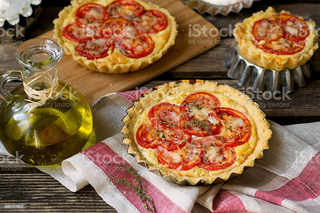 French savoury pie quiche with cottage cheese and tomatoes stock photo