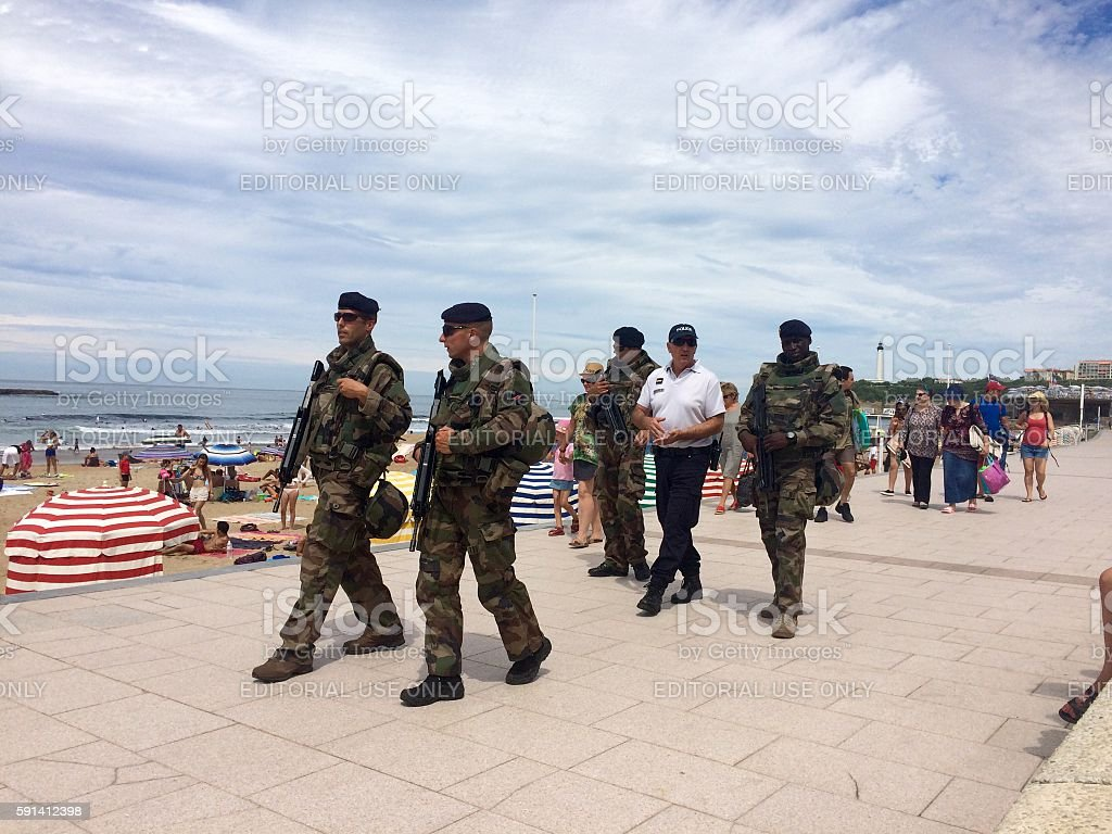 French soldiers patrolling in Biarritz France stock photo