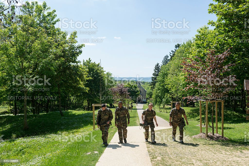 French soldiers walk in Fleury-devant-Douaumont stock photo