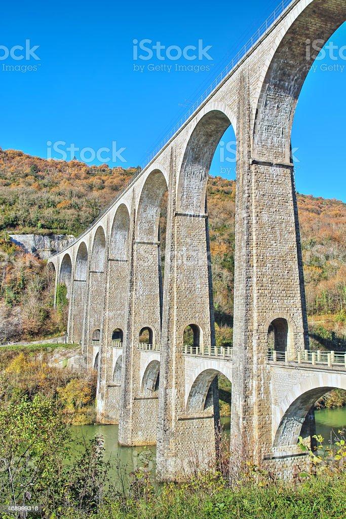 French stone viaduct bridge in Rhone-Alpes region in autumn season stock photo