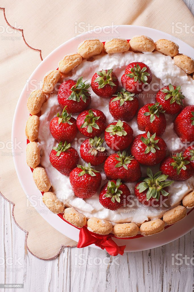 French Strawberry charlotte closeup on the table. vertical top v stock photo