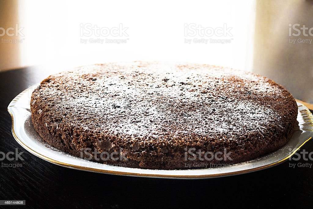 French style chocolate cake topped off with powdered sugar stock photo