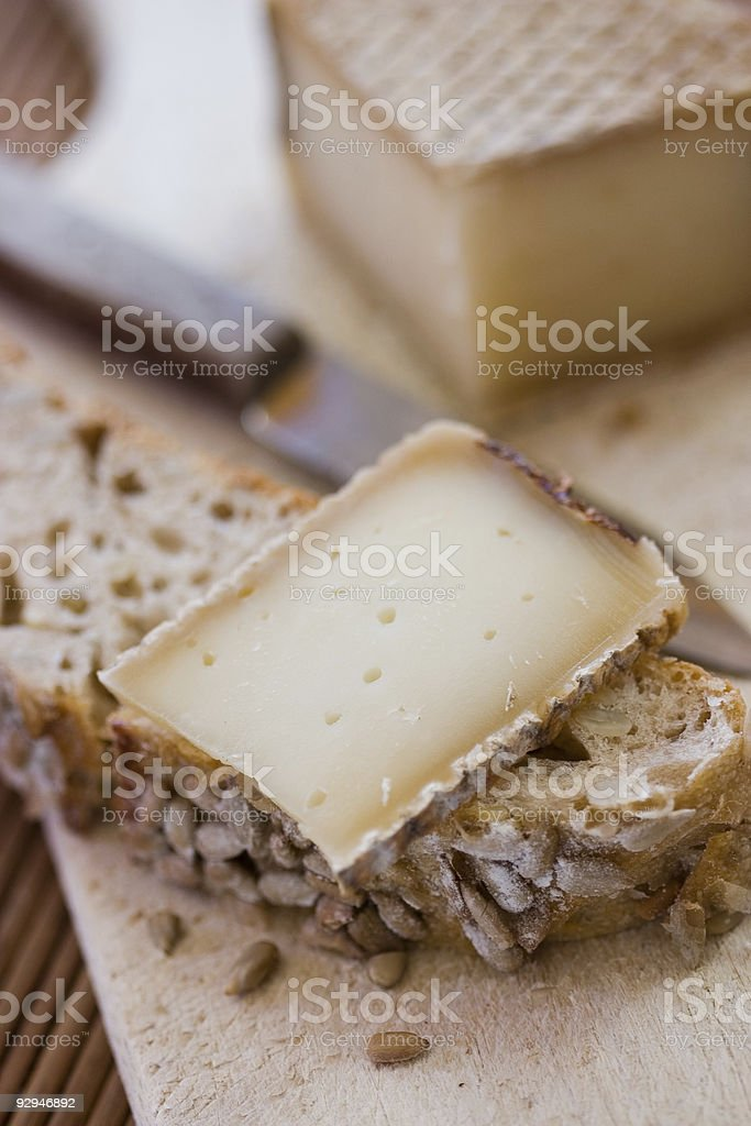 French tasty slice of cheese stock photo