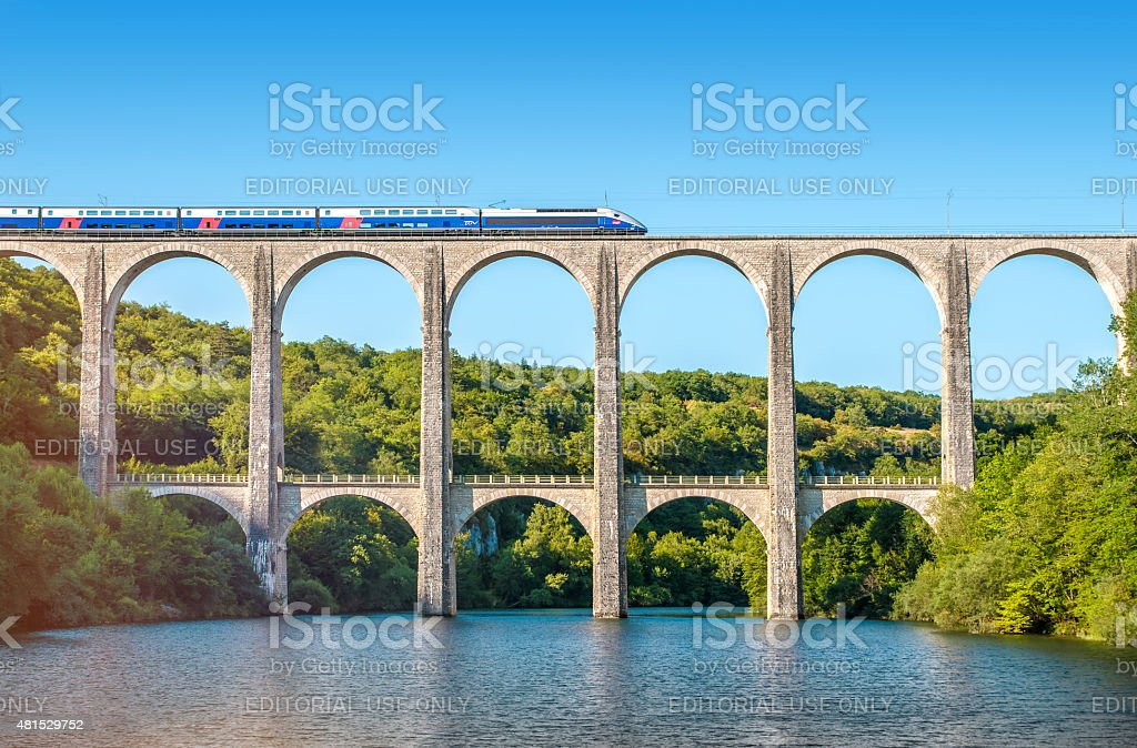 French TGV train on stone viaduct in Rhone-Alpes France stock photo