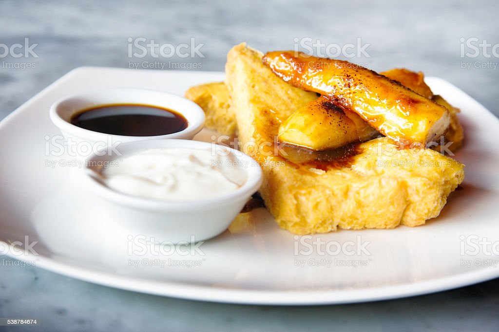 French toast and caramelized bananas breakfast stock photo