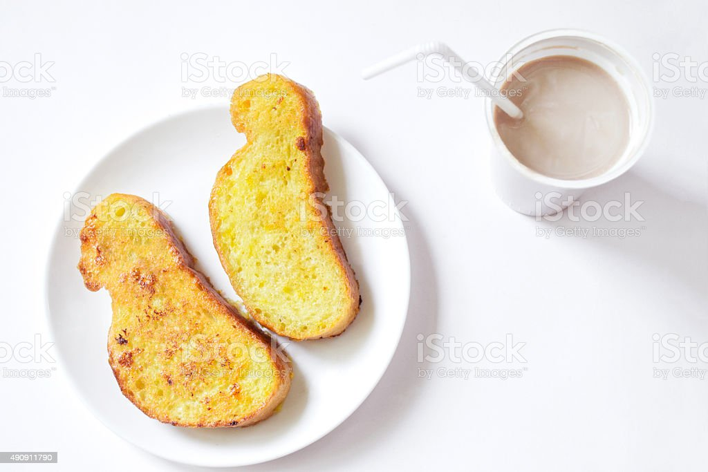 French toast and chocolate milk for breakfast stock photo