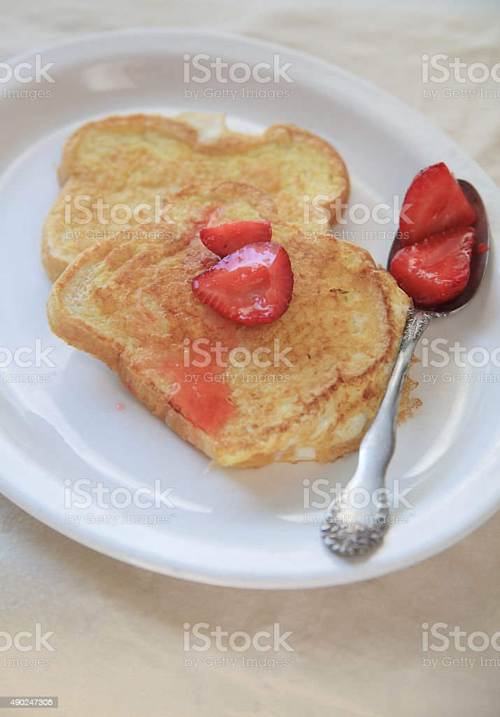 French toast and sweetened strawberries with copy space stock photo