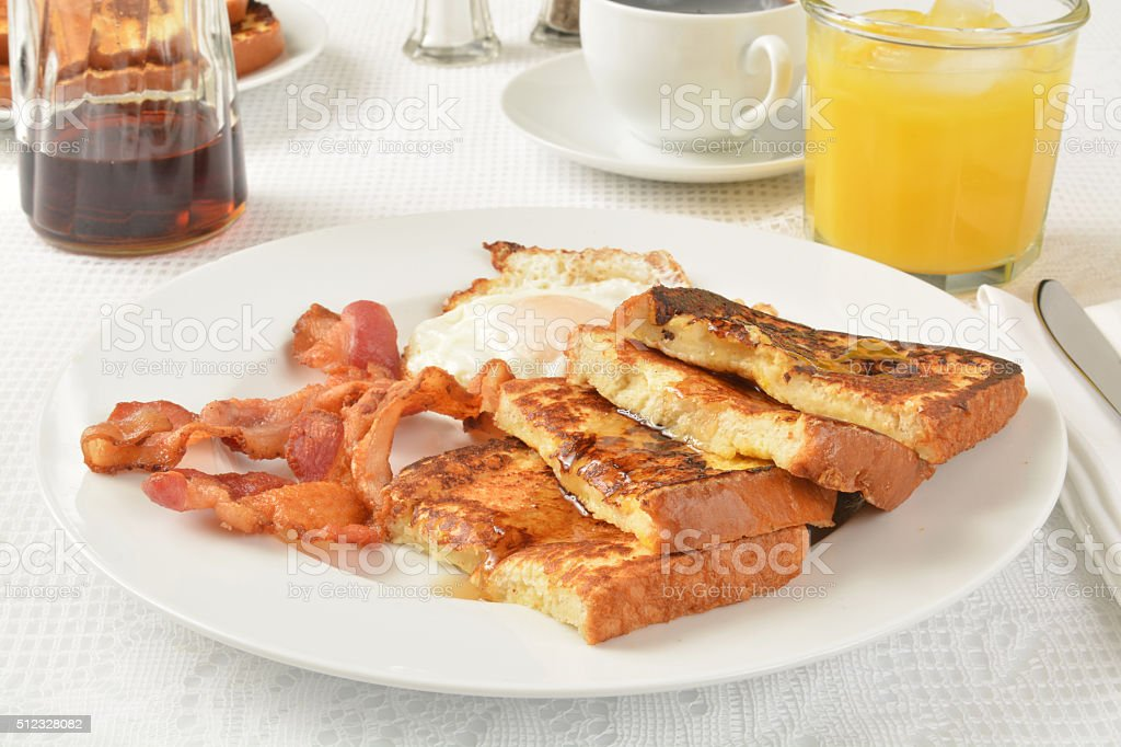 French toast, bacon and eggs stock photo