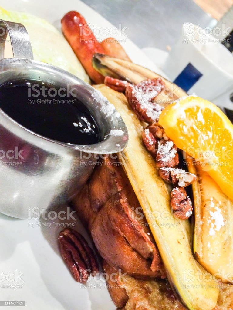 French Toast Brunch with Maple Syrup, Bananas, Oranges and Coffee stock photo