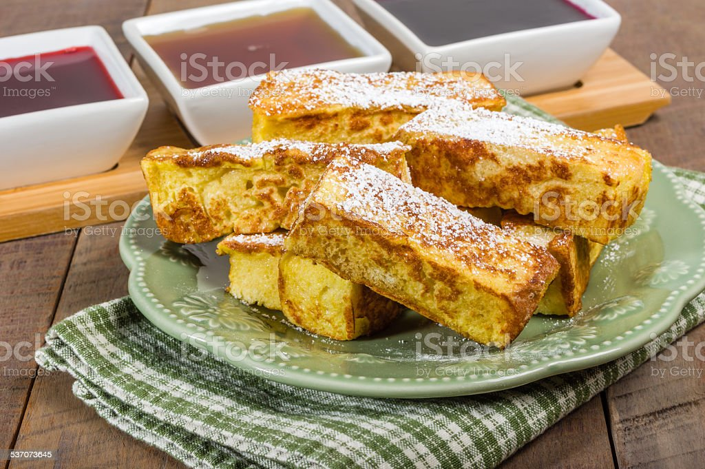 French toast sticks with syrups stock photo