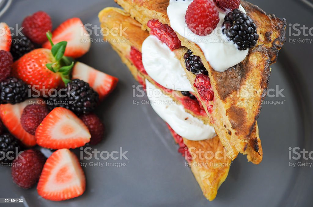 French toast stuffed with berries stock photo