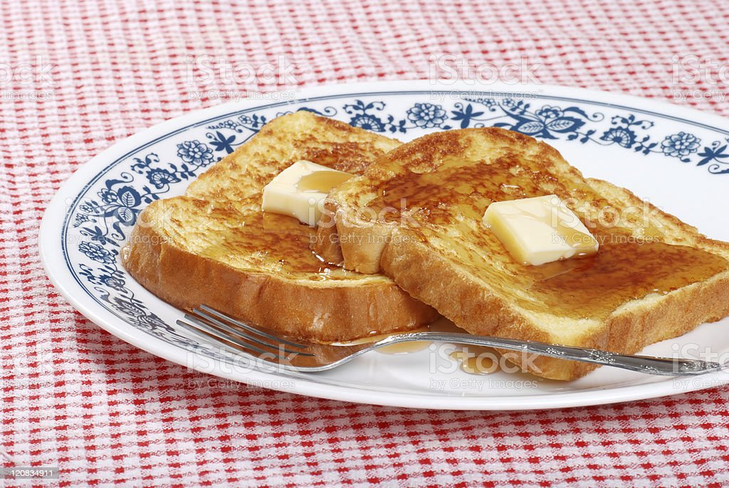french toast syrup and fork stock photo