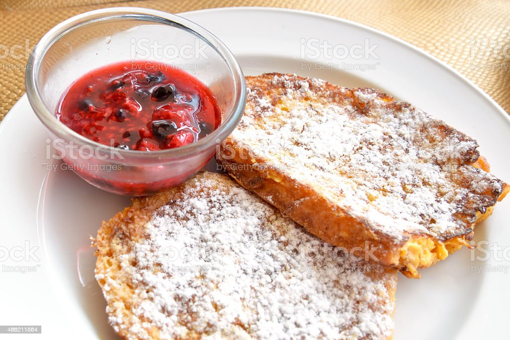 French toast with berry compote stock photo