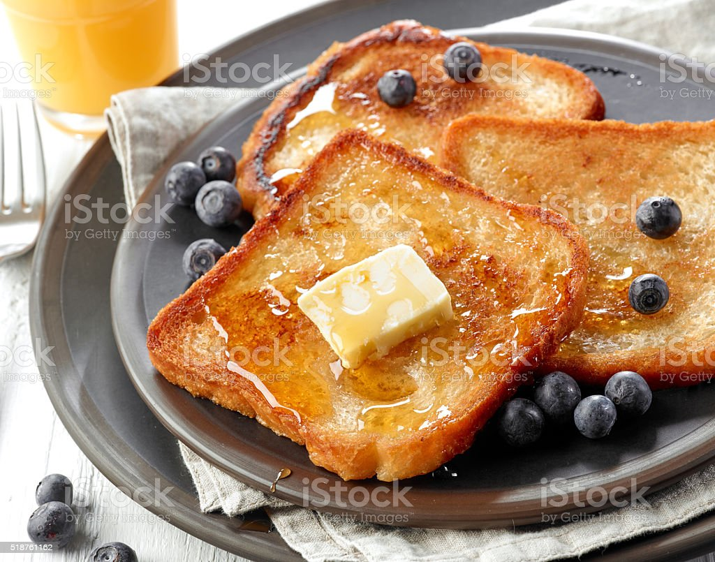 French toast with butter and honey stock photo