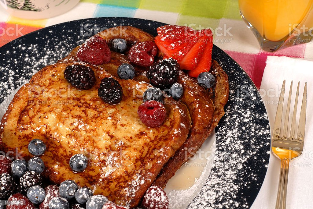 French toast with fruit and maple syrup closeup stock photo