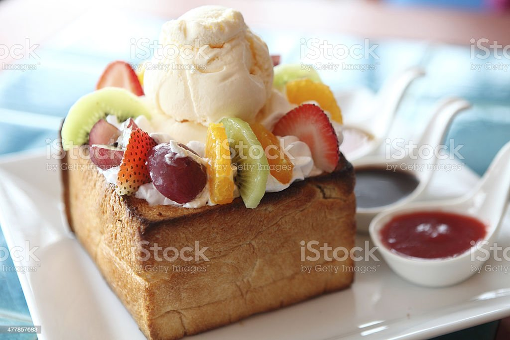 french toast with ice cream and fruit stock photo