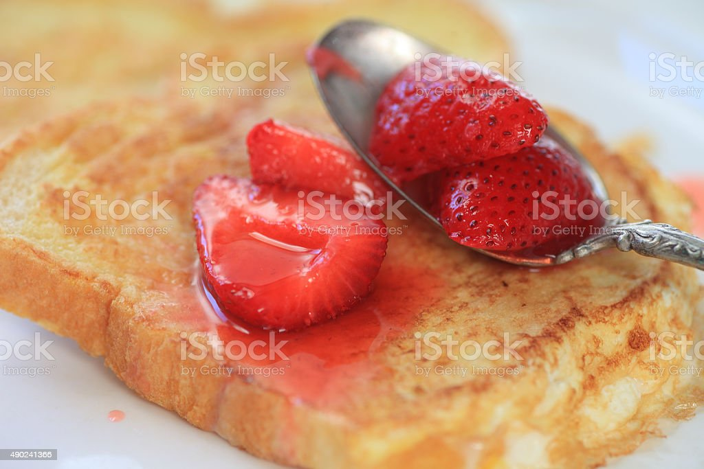 French toast with macerated strawberries stock photo