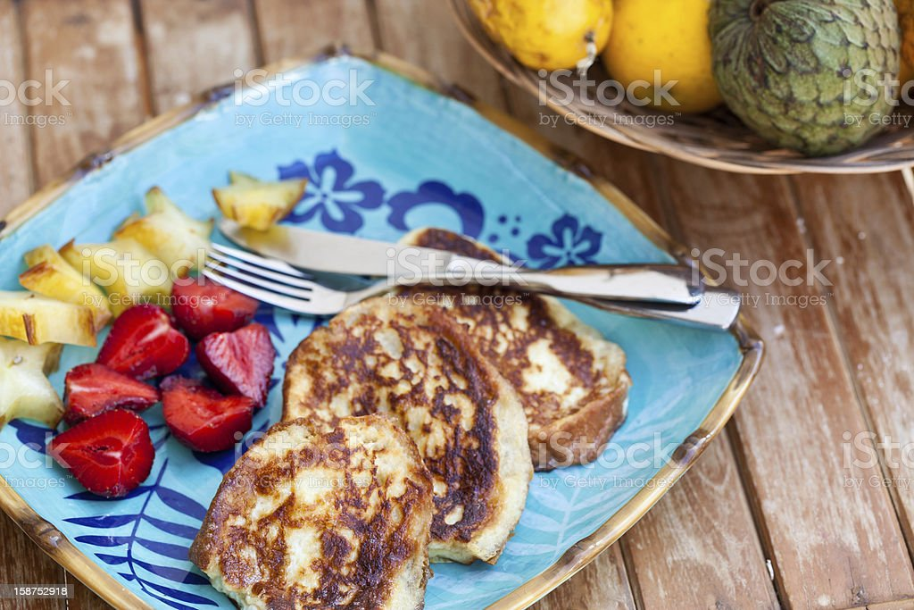French toast with sliced fruits. stock photo