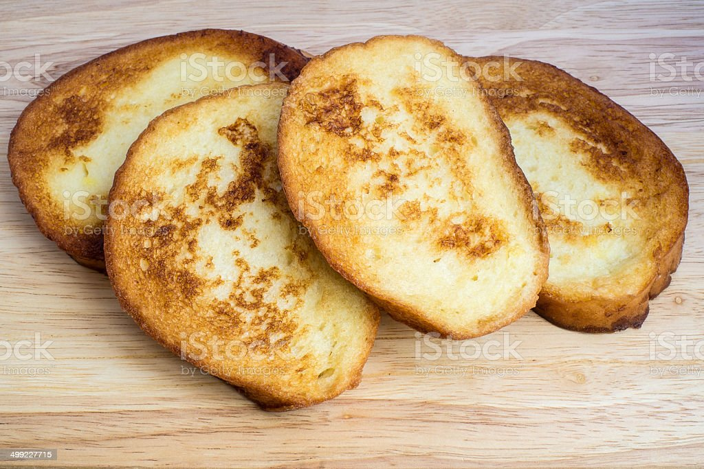 French toasts on the wooden desk stock photo