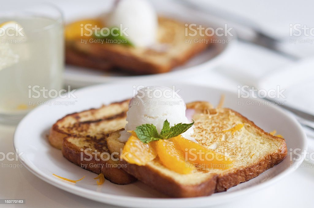 French toasts with ice cream and orange slices royalty-free stock photo