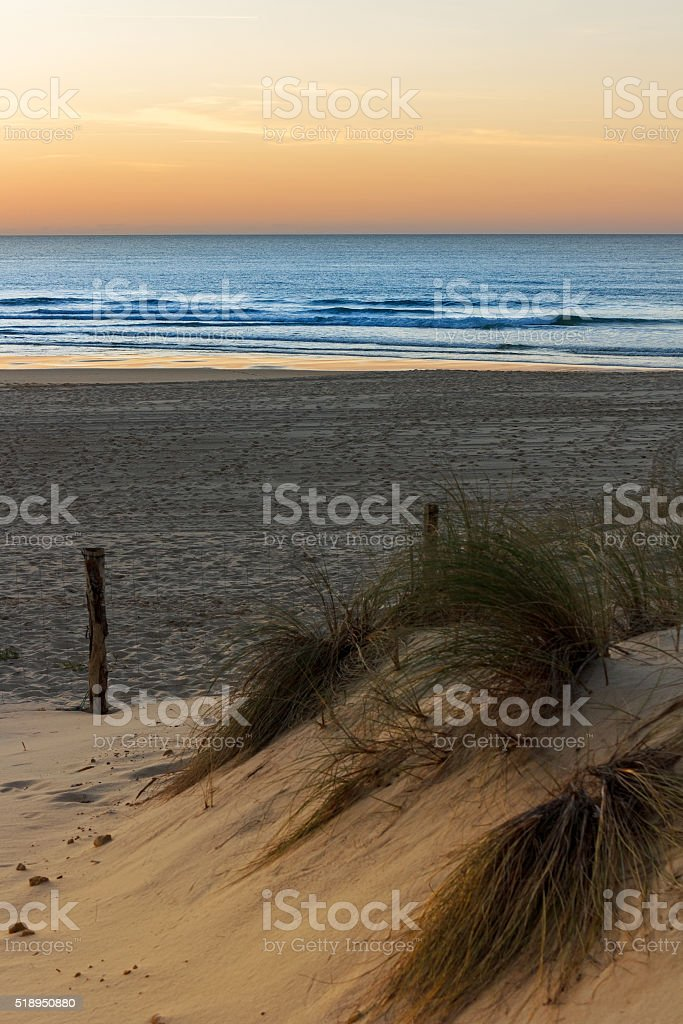 French travel background: Sunset at the beach of Mimizan Plage stock photo
