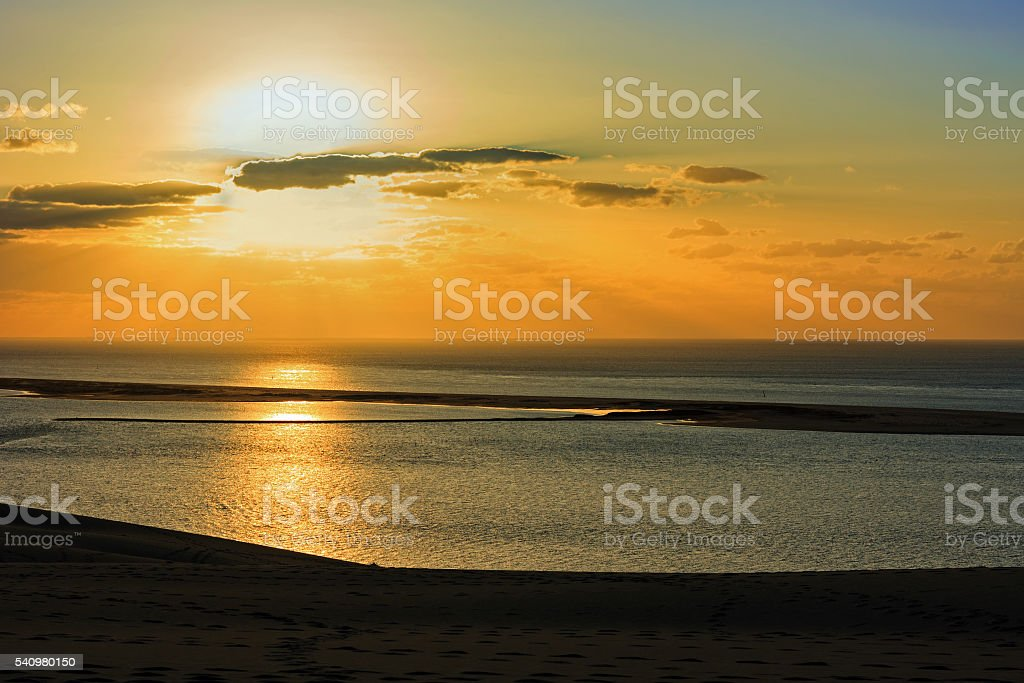 French travel destination: View from Europe's highest dune with sunset stock photo