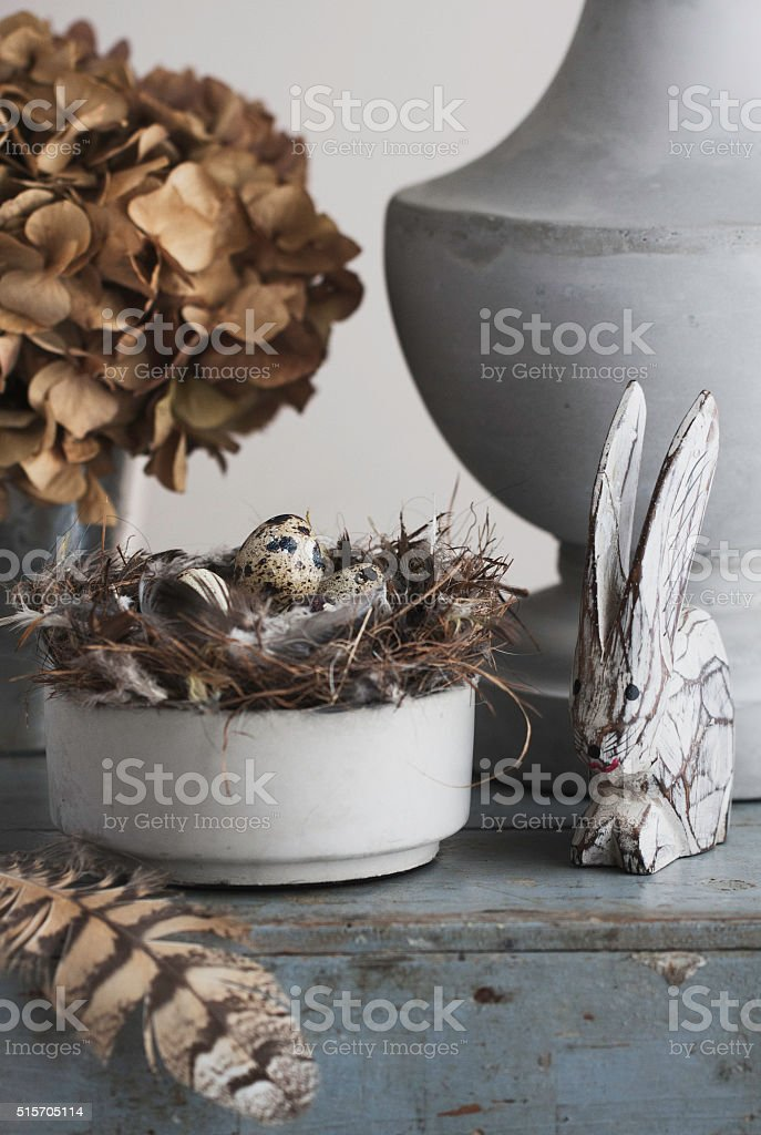 French vignette decor styling with nest, eggs and feather stock photo