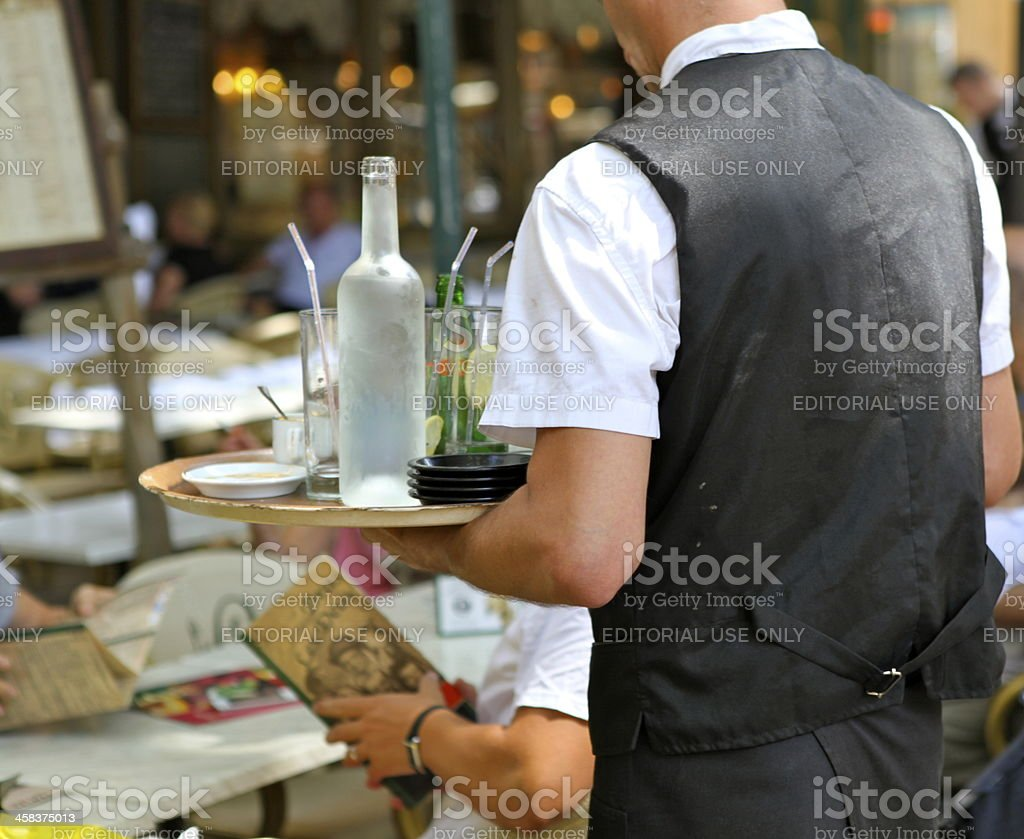 French waiter serving at cafe royalty-free stock photo