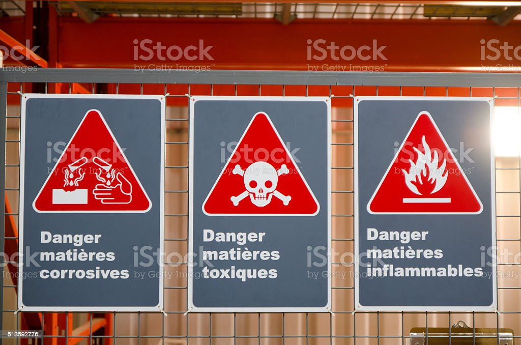 French warning signs on screen/grid door of toxic chemical closet stock photo