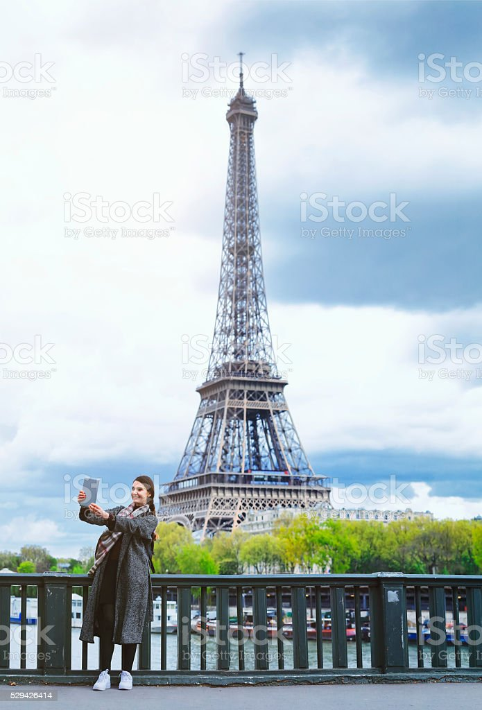 French woman taking selfie with digital tablet  (panoramic) stock photo