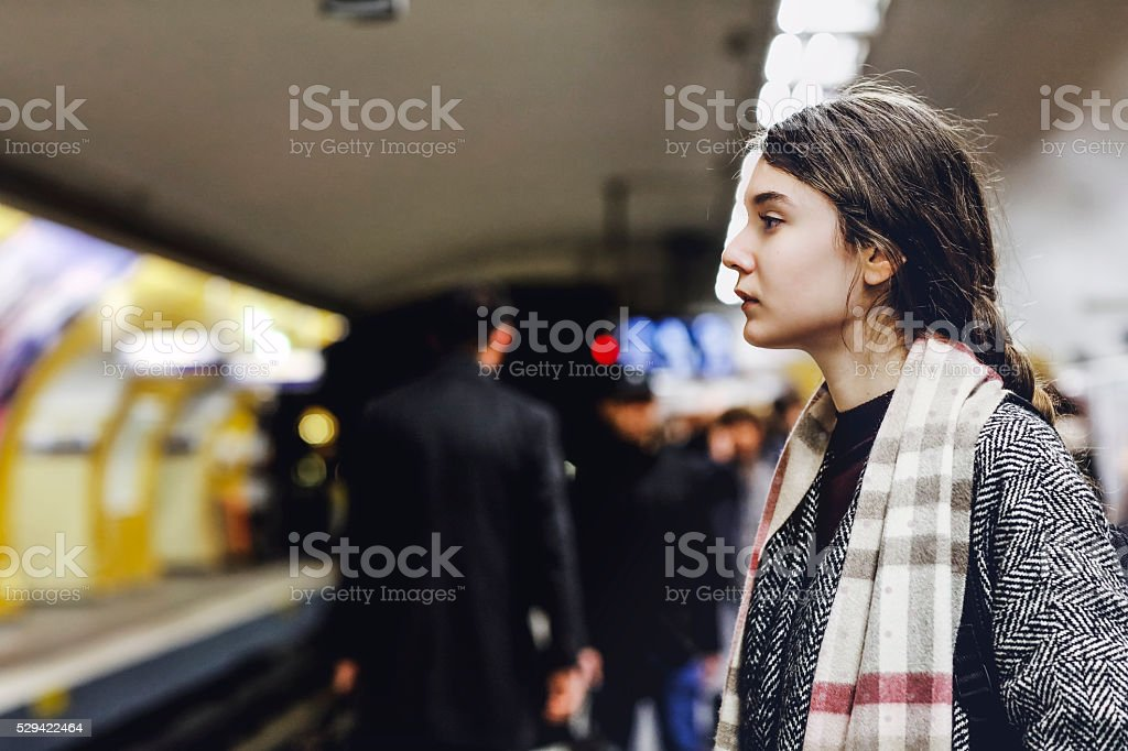 French woman waiting for the subway  train, Paris, France stock photo