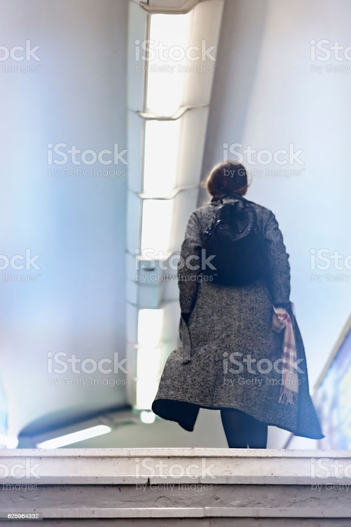 French woman walks in Paris metro stock photo