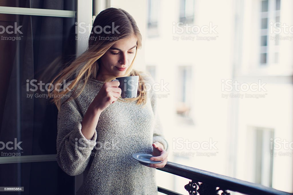 French Woman with Cap of Coffee stock photo