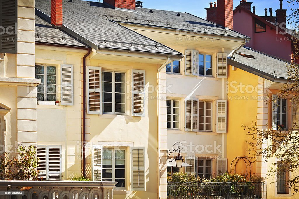 French yellow houses in sunny day with Windows open stock photo
